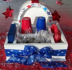 - Fourth of July party tableware organizer utensil caddy. White with blue stars ribbon. Holds napkins, paper plates, utensils and more Fourth of July party tableware organizer utensil caddy. Fourth Of July Decor, 4th Of July Decorations, 4th Of July Party, July 4th, Patriotic Party, 4th Of July Food Sides, Memorial Day Decorations, Patriotic Crafts, A Table