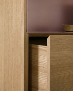 Designer Mario Ruiz combines natural and stained woods with polished and anodized aluminum in his new collection of sideboards for Punt called Stockholm. The rectilinear structures are composed of wood, as are the drawers which are free from hardware. Each sideboard's top has an aluminum skin that continues up three of its sides. The aluminum comes in gold, pale rose, black, silver or bronze and the units themselves are available in several heights and widths.