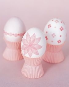 Tissue-Paper-Decorated Eggs:  Perched on baking-cup pedestals, these plain blown eggs were decorated with cutouts from folded pastel tissue paper.