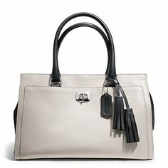 Black and white leather purse (this one is from Coach).  Grey instead of black might be nice, too