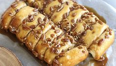 Pecan Caramel Rolls that make a perfect breakfast pastry or yummy dessert. Delicious sweet rolls that can be made in under 30 minutes using pillsbury biscuits