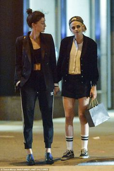 Love is in the air: Kristen Stewart and St Vincent held hands on a romantic date on Sunday in the East Village