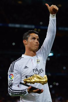Cristiano Ronaldo of Real Madrid CF shows to the audience his third Golden Boot award as best European scorer prior to start the La Liga match between Real Madrid CF and Rayo Vallecano de Madrid at Estadio Santiago Bernabeu on November 8, 2014 in Madrid, Spain.