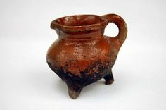 15th century Low Countries redware. Pipkin. Vessel represents widespread type of pottery imported into Britain during late medieval period.