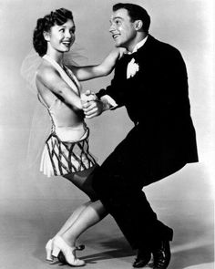 Debbie Reynolds and Gene Kelly. Singing in the Rain.