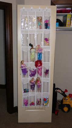 Barbie holder, or any other small toys for that matter.  $5 shoe holder at Walmart and 4 command hooks.  Awesome!!