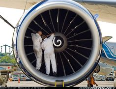 Brand new GE90 almost installed, mechanics just finishing up the engine swap. An unusual sight at BOS.
