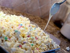 White chocolate popcorn for gifts. I used 2 bags white chocolate chips, 1 bag of M&M's and 4 bags of popcorn (kettle corn). Could probably have used more popcorn and had it less drizzled. Really easy and good. Will make again :)