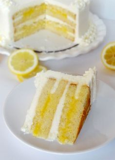 Triple Lemon Cake - My favorite part of this cake is seeing the smart way this baker put icing on the outer edges of the layers so the filling doesn't leak out!  Now, maybe I'm the only one on earth who didn't know to do that?  I've always had such a messy time frosting cakes with fillings.  Now I know how to do it cleanly!!!!! Yeah!