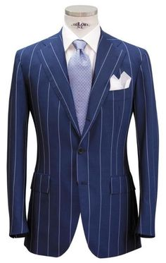 A handsome Italian bespoke suit, forming a perfect business ensemble. The suit is cut beautifully, with nice stylistic details (the straight cut pockets and two-third roll button) and the use of a classic pinstripe and subtle tie against the bright blue suit is inspired.