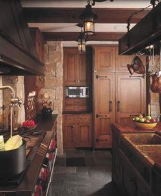 A potfiller faucet over the range provides modern convenience—as does the side-by-side refrigerator, which is integrated into the cabinetry with custom panels and distinctive wrought-iron hardware