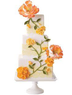 Orange Sugar Flower Cake by Truli Confectionary Arts. Via The Knot.