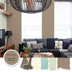 Industrial Rustic Style | The earthy tone of this transitional neutral paint color is perfect as a livelier alternative to beige and a soft counterpoint to bolder tones. This light brown paint color paired with a hint-of-mint accent wall — keeps a living room's black leather couch and modern decor touches feeling livable.