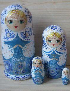 Smiling matryoshkas (Russian nesting dolls) in blue outfits. #Russian #folk #art #matryoshka
