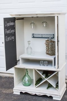 Wine Hutch all finished!! My TV armoire repurposed into a wine rack. This DIY was kind of a pain, painting, glazing, distressing, but it turned out great! Tags: DIY ROADSIDE REVIVALS repurpose shabby chic wine rack white distressed vintage