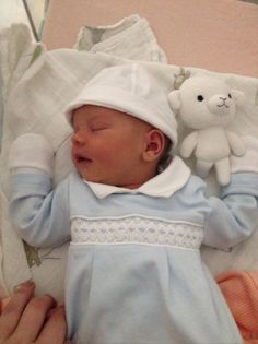 Smocking and embroidery make baby's first wardrobe extra special
