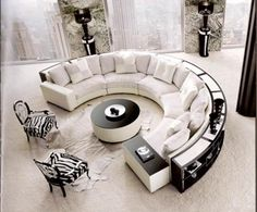 Circular sofa + circular bookshelf!?!?  I LOVE round couches, and this one has a book case! Oh Ya Baby! That is totally my style, now i just need somewhere big enough to put it! Ü