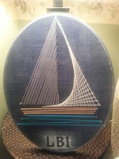 Sail away with this string art! The sailboat is on a navy blue and white rustic plaque with LBI (for Long Beach Island) on the bottom. Any initials or word can fit on the bottom. If you prefer a word other than LBI, please include it in a message when you order.