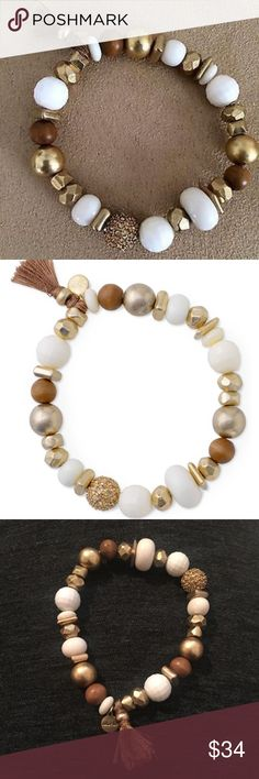 Meredith Stretch Bracelet by Stella & Dot Brand new and comes with the original packaging. Tag on the back of the gift box. A golden pave ball of handset stones lends sparkle to a stretch bracelet accented in beads of wood, ivory acrylic, and golden nuggets. Vintage gold finish. Fits SM-LG wrists. Stella & Dot Jewelry Bracelets