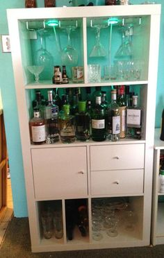 "White Expedit/Kallax 4x2 bookshelf ""Ikea Hack"" converted into a bar - though can easily be converted back into a bookcase if desired.  Unit comes with metal bar rails installed at the top to"