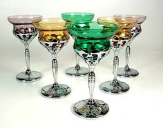 A beautiful set of 1930's Art Deco martini glasses in amethyst, amber and emerald glass with chrome bases by Farber Brothers, New York.