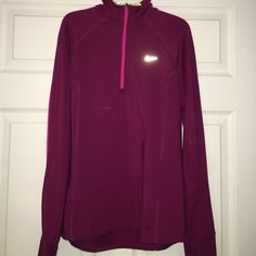 Nike Magenta Pullover Great Condition Nike DriFit 1/4 Zip Pullover! Magenta/pink combo. Thumb holes! Small area on back defect in fabric-not a hole! Pictured above Nike Jackets & Coats
