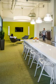 DivcoWest breakroom counter to communal seating and open office.