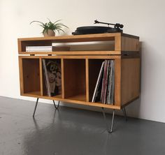 Solid wood Vinyl Storage Cabinet, or Media Console, Record Player Stand, in stock. Solid Wood construction with a dark stain, on mid century hairpin legs. Vinyl Record Cabinet, Vinyl Record Storage, Vinyl Room, Wood Vinyl, Apartment Furniture, Diy Furniture, Stockage Record, Record Player Console, Solid Wood Cabinets