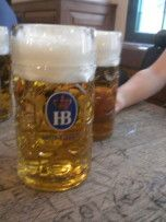 The Hofbräuhaus in Munich, Germany is an AMAZING place for beer, conversation, traditional music, and pork knuckle if you are into that sort of thing. (Which you should be because it goes GREAT with the beer!)    There is also a Hofbräuhaus in Pittsburgh, PA which is a lot of fun, but if you are going for the beer/food experience I suggest making the trip across the pond.    Cheers!