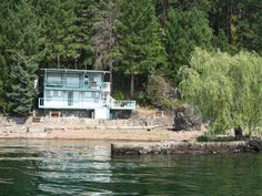 Coeur d'Alene Lake, Turner Bay Area, 95' frontage, 624 sq ft, 2 bdrms, 1 bath cottage, sit down close to water, bedrooms have outside entrance in basement, rock jetty protects dock area. Approved short sale. All offers subject to short sale.