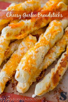 Soft and fluffy garlic infused breadsticks covered in melted cheese. Step-by-step visuals to help guide you included! Recipe at sallysbaking...