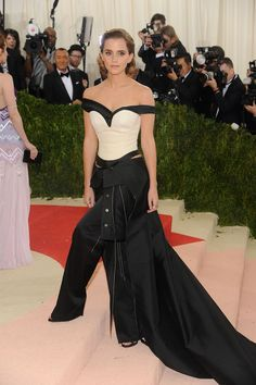 Emma Watson's Met Gala 2016 dress was made out of...garbage? Learn more about the star's unconventional dress here: