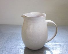 small white creamer  4 1/2 inches tall by JDWolfePottery on Etsy, $24.00