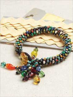 Bring the east to your wrist and learn the Japanese technique of kumihimo. This bracelet is bursting with color like a Japanese kihmono. Don, t be fooled! This technique may look hard, but it is actually perfect for any beader.Required