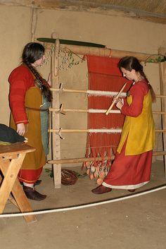 Viking reenactors with warp weighted loom at Haithabu in 2008