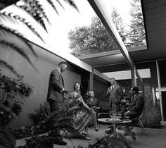 Vintage Eichler photo by Ernie Braun play up the atrium as an entertainment center.