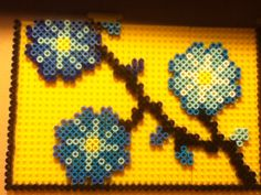 Flowers picture frame project perler beads by Tiara Cunningham