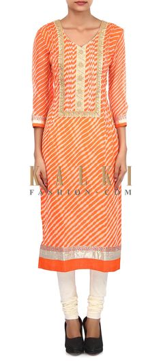 Buy Online from the link below. We ship worldwide (Free Shipping over US$100). Product SKU - 305755.Product Link - http://www.kalkifashion.com/orange-and-cream-kurti-adorn-in-pleat-only-on-kalki.html