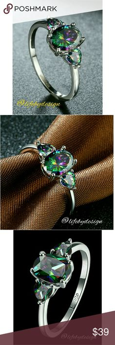 2.13ct Natural Mystic Fire Rainbow Topaz in 18k WG 2.13ct LUXURY CUT Natural Mystic Fire Rainbow Topaz Cocktail Ring in Pure Solid 18K White Gold. Handmade by master jewellers.  This is one of the prettiest rings I have had in my closet. The band is thin and the stones give off a beautiful rainbow of color. Life by Design  Jewelry Rings