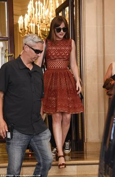 On trend: The star was surrounded by her capable security team before she made her way thr...