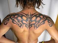 Upper back tribal tattoo design that goes from shoulder to shoulder. Great symmetry and tight lines make up this outstanding tribal design pattern. Good color, uniqueness and good alignment makes for an effective tribal tattoo. Something tells me that this person is not done yet getting more tribal tattoos on the back.