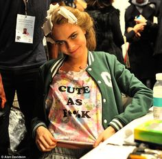 No nerves here! Cara Delevingne plays up to the camera in her rude T-shirt before taking to the catwalk in tracksuit bottoms at Issa show rehearsal Jodie Kidd, Rude T Shirts, Minnesota Twins Baseball, Pose For The Camera, Tracksuit Bottoms, Vogue Covers, Fashion Tag, Old Models, Bright Stars