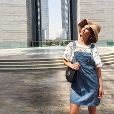 Picked up one of the outfits I did for my edit @boutique_1 and went to see this amazing building in the financial district here in Dubai. Dress by @framedenim top by @Tibi bag by @chloe and hat by @helenkaminski