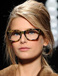 Fresh hair and makeup. Tortoise shell glasses.