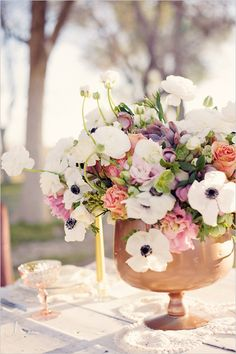 peach, purple, pink and white floral centerpieces http://www.weddingchicks.com/2013/07/23/enchanted-garden-wedding-ideas/