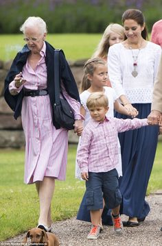 Crown Princess Mary appeared undisturbed by the Queen's proximity to her children while pu...