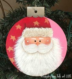 Wood Christmas ornament, hand painted Santa ornament on pink background, Christmas tree ornament by countrylanefolkart on Etsy https://www.etsy.com/listing/256310797/wood-christmas-ornament-hand-painted