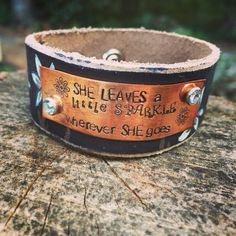 """Handcrafted leather """"she leaves a little sparkle wherever she goes"""" cuff bracelet with painted flowers by WildArrowStudio on Etsy https://www.etsy.com/listing/235281239/handcrafted-leather-she-leaves-a-little"""