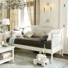 Designed in the elegant yet comfortable Louis XVI style, this beautifully carved Daybed is ready to receive guests day or night. Its woven cane arms and back are surrounded in richly layered moulding finished with ball finials and rope detail.