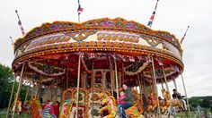 Sarah Willcock and her daughter Nieva, enjoy a ride on a carousel at a old style traditional fairground in honour the Queen's Diamond Jubilee in the grounds of Alnwick Castle, Saturday, June 2, 2012. (AP / Scott Heppell)